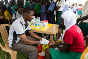 Health worker administers a test for HIV